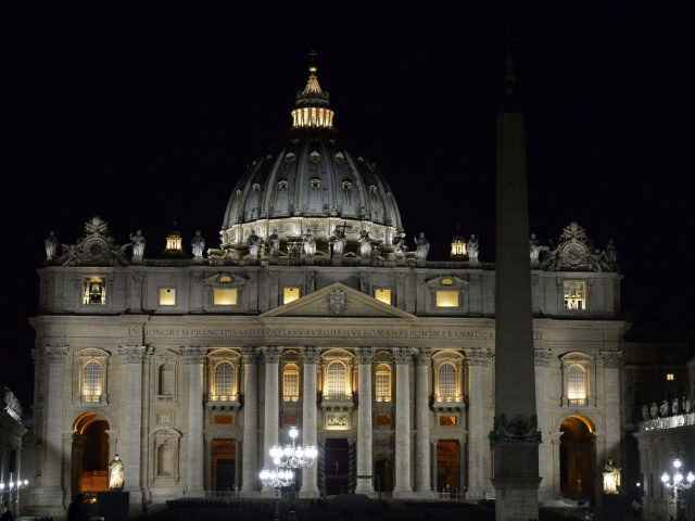 """A picture shows St Peter's basilica at night ahead of the WWF """"Earth Hour"""" campaign for global climate change awareness on March 16, 2016 in Rome. Lights went off in thousands of cities and towns across the world on today for the annual Earth Hour campaign, which is aiming to …"""