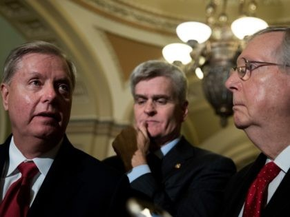 WASHINGTON, DC - SEPTEMBER 26: (L to R) Lindsey Graham (R-SC), Bill Cassidy (R-LA) and Majority Leader Mitch McConnell (R-KY) take questions from reporters during a news conference following their weekly policy luncheon, September 26, 2017 in Washington, DC. Leader McConnell announced they will not vote on the Graham-Cassidy health …