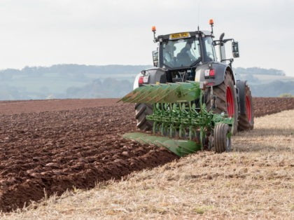 TAUNTON, ENGLAND - OCTOBER 15: A modern tractor is used to plough a field at the 67th British National Ploughing Championships at Bishop's Lydeard near Taunton on October 15, 2017 in Somerset, England. With the agricultural industry facing an uncertain future post-Brexit, the annual event which is held in a …
