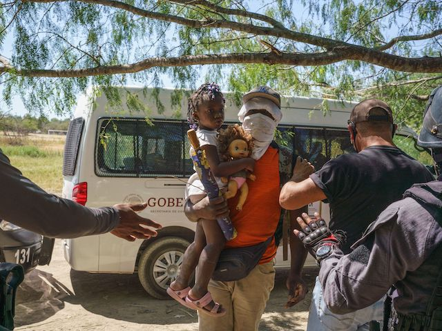 Mexican police stop a Haitian man with a young girl from crossing the Rio Grande back to the United States in Parque Ecologico Braulio Fernandez, Mexico, on September 23, 2021. (Paul Ratje/AFP via Getty Images)