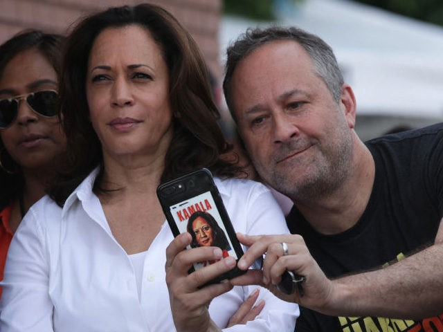 DES MOINES, IOWA - AUGUST 10: Douglas Emhoff, husband of Democratic presidential candidate U.S. Sen. Kamala Harris (D-CA), takes a selfie prior to her delivering a campaign speech at the Des Moines Register Political Soapbox at the Iowa State Fair on August 10, 2019 in Des Moines, Iowa. 22 of …