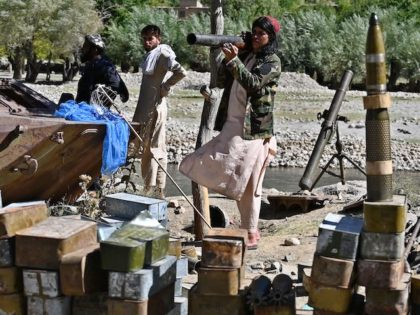 Taliban fighters stand next to ammunition along a road in Malaspa area, Bazark district, Panjshir Province on September 15, 2021, days after the hardline Islamist group announced the capture of the last province resisting to their rule.(Wakil Kohsar/AFP via Getty Images)