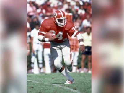 Sep 26, 1981, Athens, GA, USA; FILE PHOTO; Georgia Bulldogs running back Hershel Walker (34) carries the ball against the South Carolina Gamecocks at Sanford Stadium. Mandatory Credit: Malcolm Emmons-USA TODAY Sports
