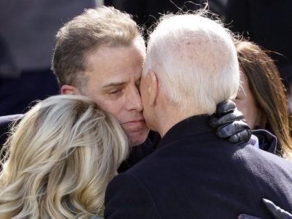 President Joe Biden hugs first lady Jill Biden, his son Hunter Biden and daughter Ashley Biden after being sworn-in during the 59th Presidential Inauguration at the U.S. Capitol in Washington, Wednesday, Jan. 20, 2021. (AP Photo/Carolyn Kaster)
