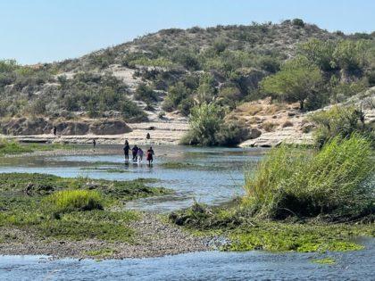 A group of Venezuelan and Colombian migrants cross the Rio Grande near Del Rio, Texas. (Photo: Randy Clark/Breitbart Texas)