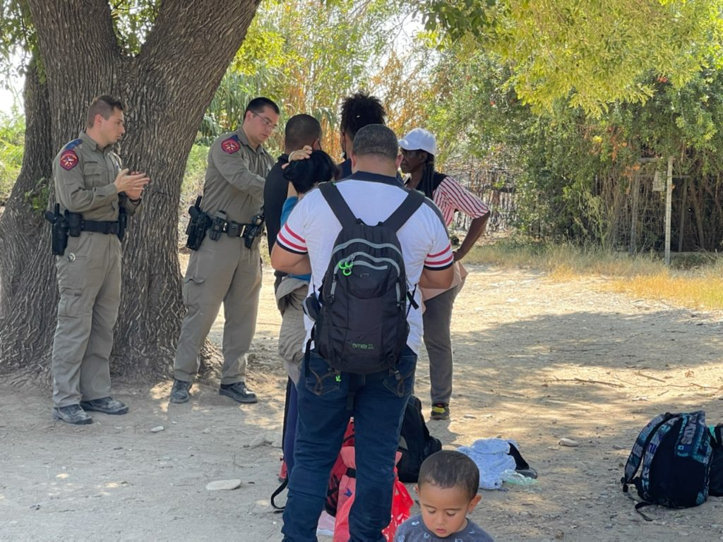 Texas Department of Public Safety Troopers arrest a Venezuelan migrant for trespassing after the group crossed the Rio Grande onto private property. (Photo: Randy Clark/Breitbart Texas)