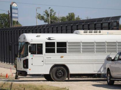 CBP Contract Bus for migrants at Del Rio encampment. (Photo: Randy Clark/Breitbart Texas)