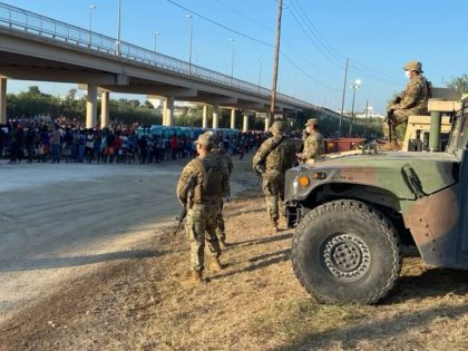 Texas National Guard troops stand by to assist outnumbered Border Patrol agents as more than 12,000 migrants are detained in Del Rio, Texas. (Photo: Office of the Texas Governor)