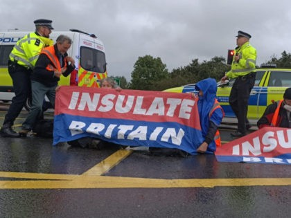 Police intervening during an Insulate Britain protest near Junction 14 of the M25 near Heathrow airport on the morning of Monday the 27th of September (Photo by Insulate Britain)