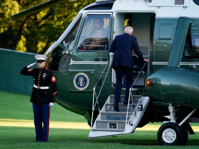 President Joe Biden boards Marine One on the South Lawn of the White House, Friday, Sept. 24, 2021, in Washington. First lady Jill Biden is seated at right. (AP Photo/Evan Vucci)