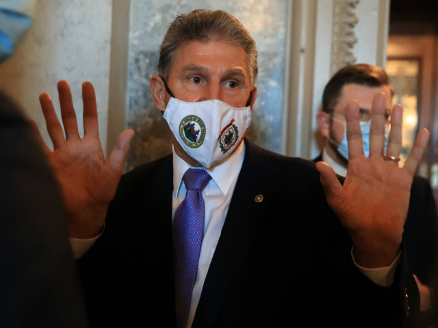 Sen. Joe Manchin (D-WV) talks very briefly with reporters after walking out of the Senate Chamber at the U.S. Capitol on September 30, 2021 in Washington, DC. A moderate Democrat, Manchin has been negotiating with his fellow senators and the White House over the spending limits on the Build Back Better Act and whether he will put the budget reconciliation plan in jeopardy. (Photo by Chip Somodevilla/Getty Images)