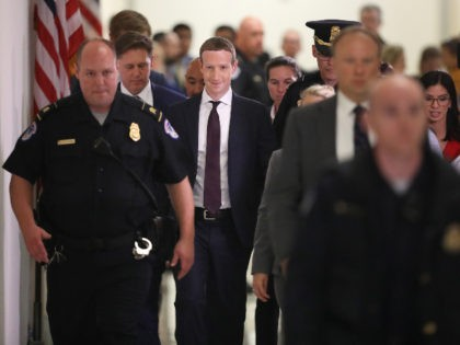 Mark Zuckerberg surrounded by guards