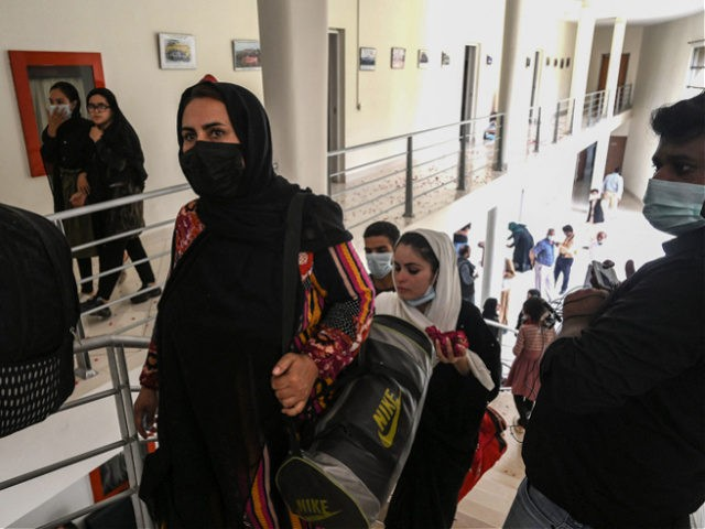 Members of Afghanistan's national girls football team arrive at the Pakistan Football Federation (PFF) in Lahore on September 15, 2021, a month after the hardline Taliban swept back into power officials said. (Photo by Arif ALI / AFP) / The erroneous mention[s] appearing in the metadata of this photo by …