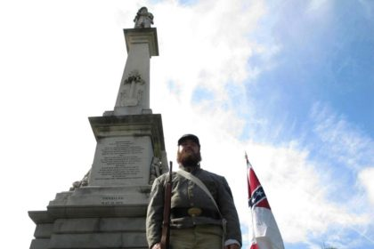 In this July 10, 2017, file photo, Cameron Maynard stands at attention by the monument to Confederate soldiers at the South Carolina Statehouse in Columbia, S.C. The South Carolina Supreme Court has upheld a 2000 law protecting Confederate monuments from being moved without a vote from the General Assembly. (AP …
