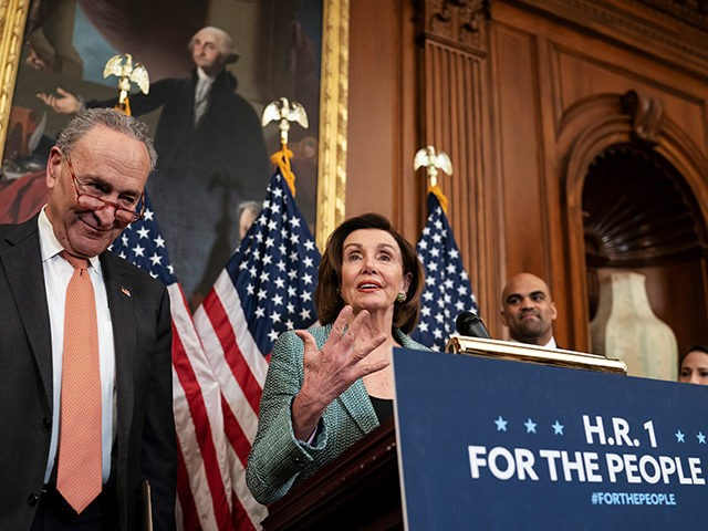 """Senate Minority Leader Chuck Schumer, D-N.Y., left, and Speaker of the House Nancy Pelosi, D-Calif., call on Senate Majority Leader Mitch McConnell, R-Ky., to bring the Democrats' HR-1 """"For the People Act"""" to the floor for a vote, during an event on Capitol Hill in Washington, Tuesday, March 10, 2020. …"""