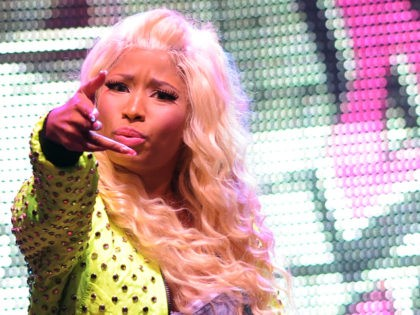 """MIAMI , FL - JULY 2: Nicki Minaj performs during the """"Pink Friday World Tour 2012 at the James L. Knight Center"""" on July 24, 2012 in Miami , Florida. (Photo by Jeff Daly/Invision/AP)"""