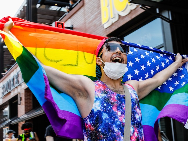 Crowds chant during the Pride Without Prejudice march in Boystown on June 28, 2020 in Chicago, Illinois. (Natasha Moustache/Getty Images)