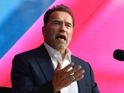 Arnold Schwarzenegger talks about Digital Sustainability during the Digital X conference in Cologne, Germany, Tuesday, Sept. 7, 2021. (Roberto Pfeil/dpa via AP)