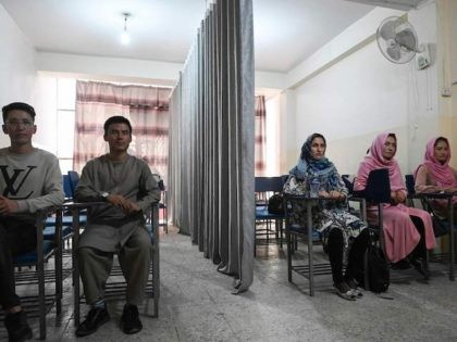 TOPSHOT - Students attend a class bifurcated by a curtain separating males and females at a private university in Kabul on September 7, 2021, to follow the Taliban's ruling. (Photo by Aamir QURESHI / AFP) (Photo by AAMIR QURESHI/AFP via Getty Images)