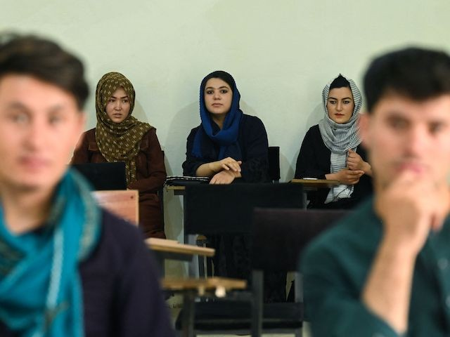 Students attend their class after private universities were reopened in Kabul on September 6, 2021. (Aamir Qureshi/AFP via Getty Images)