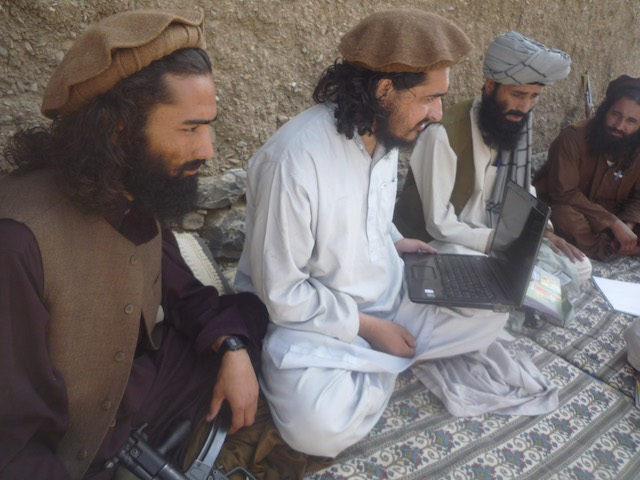New Pakistani Taliban chief Hakimullah Mehsud, center, holds a laptop computer, flanked by his comrades in Sararogha of Pakistani tribal area of South Waziristan along Afghanistan border on October 4, 2009. Mehsud vowed to strike back at Pakistan and the U.S. for the increasing number of drone attacks in the …