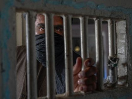 A member of the Taliban stands guard inside the Pul-e-Charkhi prison in Kabul on September 16, 2021. (Bulent Kilic/AFP via Getty Images)