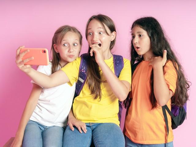 Three girls watching TikTok videos