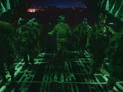 In this Aug. 30, 2021, photo provided by the U.S. Air Force, soldiers, assigned to the 82nd Airborne Division, board a U.S. Air Force C-17 Globemaster III aircraft at Hamid Karzai International Airport in Kabul, Afghanistan. (Senior Airman Taylor Crul/U.S. Air Force via AP)