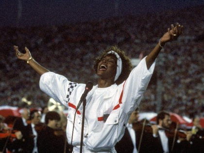 TAMPA, FL - JANUARY 27: Whitney Houston sings the National Anthem before a game with the New York Giants taking on the Buffalo Bills prior to Super Bowl XXV at Tampa Stadium on January 27, 1991 in Tampa, Florida. The Giants won 20-19. (Photo by George Rose/Getty Images)