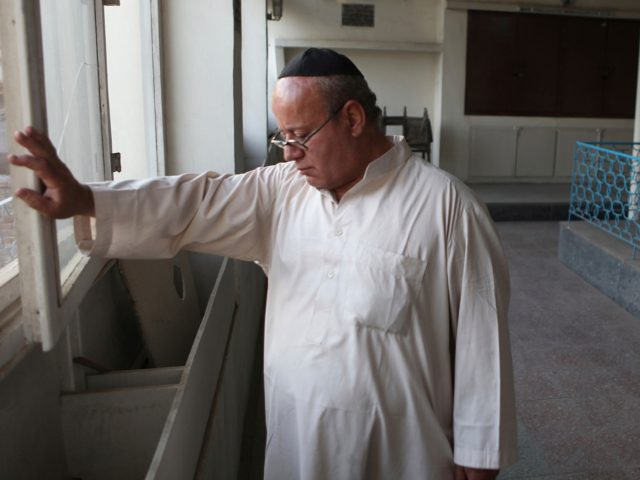 n this photo taken Saturday, Aug. 29, 2009, Zebulon Simentov, the last known Jew living in Afghanistan, closes the window to the synagogue he cares for in his Kabul home. Simentov is the caretaker and sole member of Afghanistan's only working synagogue. (AP Photo/David Goldman)