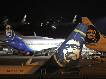 Alaska Airlines planes sit on the tarmac at Sea-Tac International Airport Friday evening, Aug. 10, 2018, in SeaTac, Wash. An airline mechanic stole an Alaska Airlines plane without any passengers and took off from Sea-Tac International Airport in Washington state on Friday night before crashing near Ketron Island, officials said. …