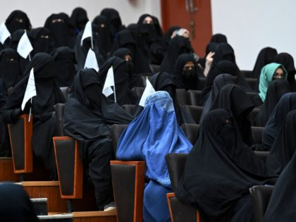 Veiled students hold Taliban flags as they listen a speaker before a pro-Taliban rally at the Shaheed Rabbani Education University in Kabul on September 11, 2021. (Photo by Aamir QURESHI / AFP) (Photo by AAMIR QURESHI/AFP via Getty Images)