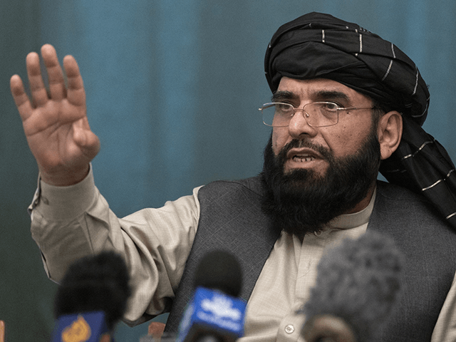 In this March 19, 2021 file photo, Suhail Shaheen, Afghan Taliban spokesman and a member of the negotiation team gestures while speaking during a joint news conference in Moscow, Russia. In an interview with The Associated Press Thursday, July 22, 2021, Shaheen said the insurgent movement does not want to …