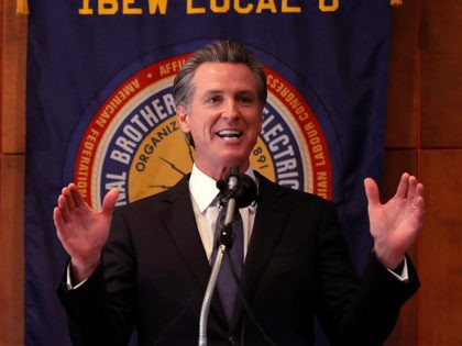 SAN FRANCISCO, CALIFORNIA - SEPTEMBER 14: California Gov. Gavin Newsom speaks to union workers and volunteers on election day at the IBEW Local 6 union hall on September 14, 2021 in San Francisco, California. Californians are heading to the polls to cast their ballots in the California recall election of …