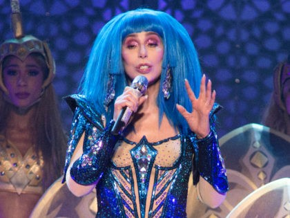 """Cher performs in concert during her """"Here We Go Again Tour"""" at The Wells Fargo Center on Friday, Dec. 6, 2019, in Philadelphia. (Photo by Owen Sweeney/Invision/AP)"""
