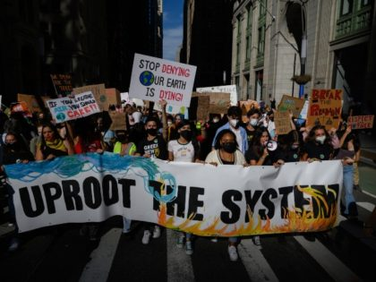 Climate activists hold placards and shout slogans as they attend a march as part of a 'Global Youth Climate Strike' organized by 'Fridays for Future New York City', a youth-run organization that aims to raise climate awareness, in New York on September 24, 2021. (Photo by ED JONES/AFP via Getty …