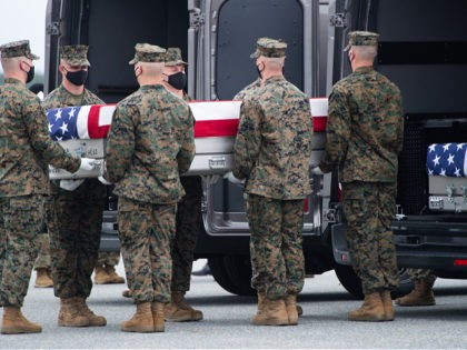 A flag-draped transfer case with the remains of a fallen service member are placed inside a transfer vehicle as US President Joe Biden attends the dignified transfer of the remains of a fallen service member at Dover Air Force Base in Dover, Delaware, August, 29, 2021, one of the 13 …