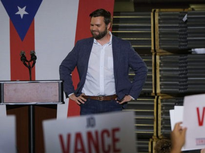"""JD Vance, the venture capitalist and author of """"Hillbilly Elegy,"""" addresses a rally Thursday, July 1, 2021, in Middletown, Ohio, where he announced he is joining the crowded Republican race for the Ohio U.S. Senate seat being left by Rob Portman. (AP Photo/Jeff Dean)"""