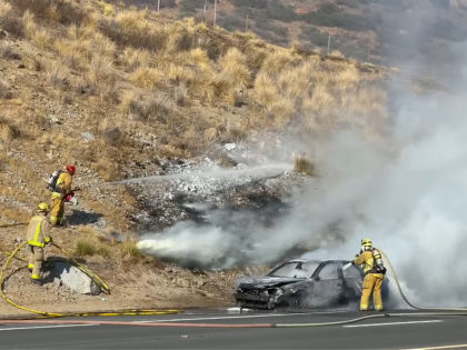 """""""This evening Lakeside units responded to reports of a vehicle fire on the westbound lanes of I8 just east of Lake Jennings. A bystander was able to capture the moment 2 other bystanders rescued the 2 elderly occupants from the burning vehicle."""""""