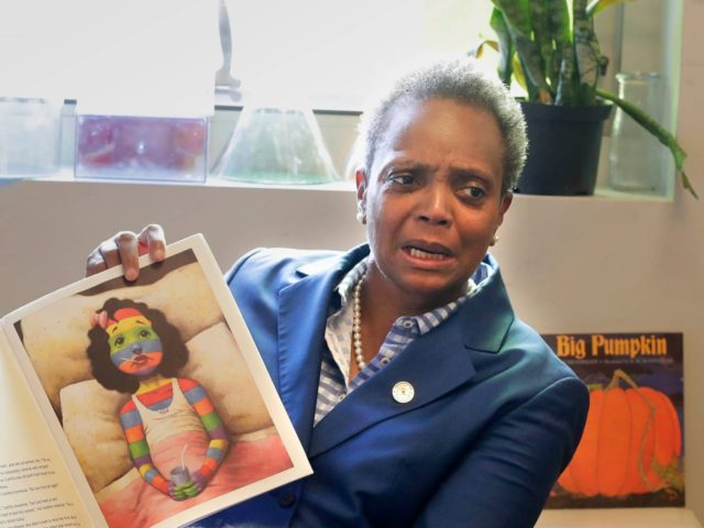Chicago Mayor Lori Lightfoot reads a book to children at Breakthrough, a nonprofit that partners with those affected by poverty. Xxx Chicago Strike 07 Wood Jpg Wi