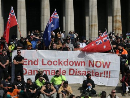 Construction workers and demonstrators on the steps of the Shrine of Remembrance protest against Covid-19 regulations in Melbourne on September 22, 2021. (Photo by CON CHRONIS / AFP) (Photo by CON CHRONIS/AFP via Getty Images)