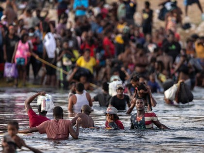 CIUDAD ACUNA, TEXAS - SEPTEMBER 19: Immigrants, mostly from Haiti gather on the bank of the Rio Grande on September 19, 2021 in Ciudad Acuna, Mexico, across the border from Del Rio, Texas. As U.S. immigration authorities began deporting immigrants back to Haiti from Del Rio, thousands more waited in …