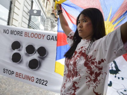 Pro-Tibet demonstrators hold a protest on June 10, 2015 outside Lausanne Palace hotel where a delegation of the Beijing 2022 Winter Olympics candidate city present their bid before IOC members and the press. AFP PHOTO / FABRICE COFFRINI (Photo credit should read FABRICE COFFRINI/AFP via Getty Images)