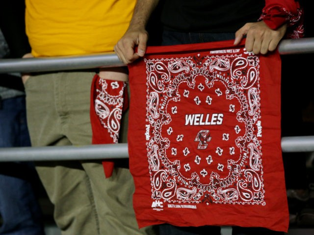Boston College Eagles fan holds a red bandana to honor Boston College alumni Welles Crowther during the first quarter of the game between the Eagles and the Florida State Seminoles at Alumni Stadium on October 27, 2017 in Chestnut Hill, Massachusetts. Crowther was a Boston College alumni who lost his …