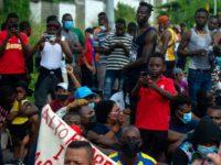 Report: Social Media Giants Helping Lead Haitian Migrants to Texas
