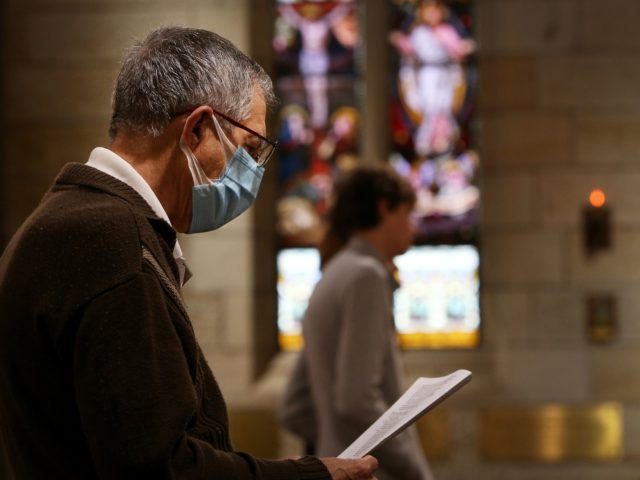 SYDNEY, AUSTRALIA - OCTOBER 25: A parishioner wears a face mask during the 'Twenty-First Sunday after Pentecost' service at St Paul's Anglican Church in Burwood on October 25, 2020 in Sydney, Australia. COVID-19 restrictions eased further in New South Wales from Friday 23 October to allow religious gatherings and places …