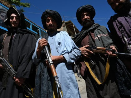 Taliban fighters pose for a picture in front of a bakery at a market area in Khenj district, Panjshir Province on September 15, 2021, days after the hardline Islamist group announced the capture of the last province resisting to their rule. - Under late Afghan commander Ahmad Shah Massoud, the …