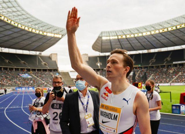 Norway's Karsten Warholm celebrates winning the men's 400m hurdles in Berlin on Sunday