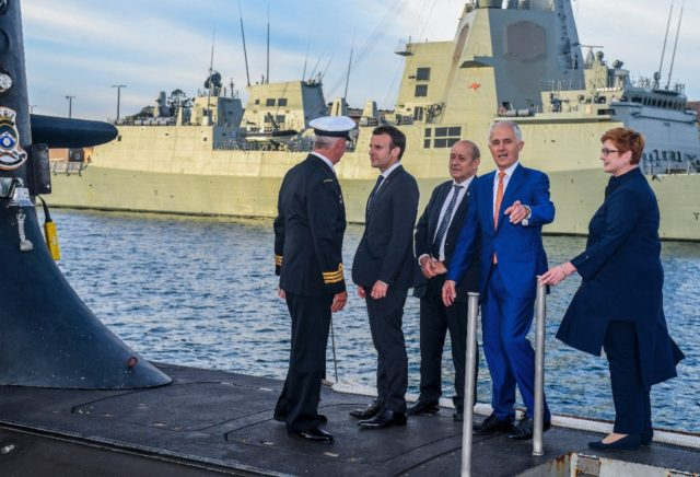 French President Emmanuel Macron and Australia's then prime minister Malcolm Turnbull stand on the deck of HMAS Waller submarine in May 2018 in Sydney as Paris fulfilled a major new contract that has since been scrapped