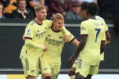 Martin Odegaard (centre) celebrates after scoring for Arsenal against Burnley
